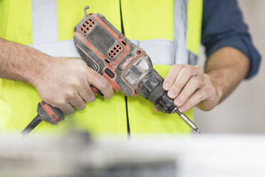 Worker holding drill - ZEF16168