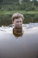 Portrait of smiling boy in a lake - VPIF01383