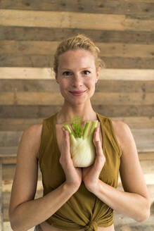 Smiling blond woman with fennel - JOSF03567