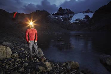 Hiker with headlamp standing at Lago de los Tres, Los Glaciares National Park, Patagonia, Argentina - CVF01318