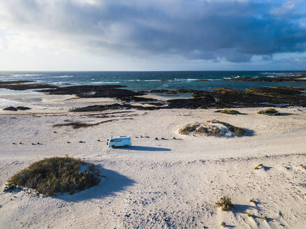 Aerial view of camping van on a sand track in Fuerteventura - SIPF02036