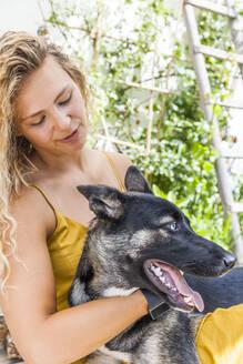 Husky shepherd mongrel dog with his mistress - TCF06149