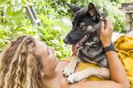 Husky shepherd mongrel dog and his mistress, face to face - TCF06152