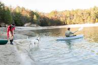 Couple kayaking in remote lake - BLEF11954
