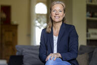 Portrait of smiling mature businesswoman at home - FMKF05746