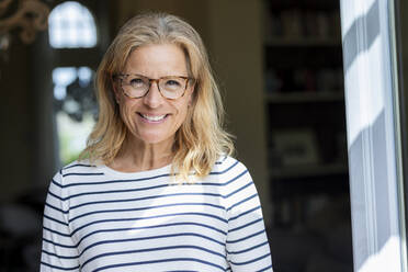 Portrait of smiling mature woman wearing glasses - FMKF05761