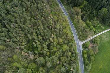 Aerial view of road through forest, Franconia, Bavaria, Germany - RUEF02267