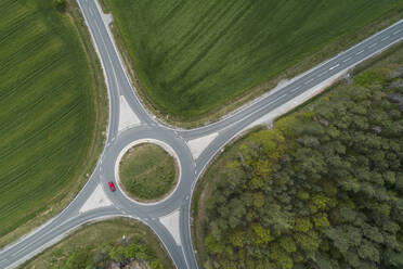 Aerial view of roundabout intersection with traffic. Franconia, Bavaria, Germany. - RUEF02270