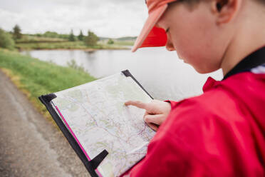 Boy looking at map, Cairngorms, Scotland, UK - NMS00325
