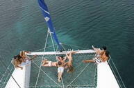 High angle view of friends sunbathing on sailboat - BLEF12174