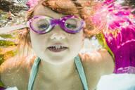 Caucasian girl swimming underwater in swimming pool - BLEF12204