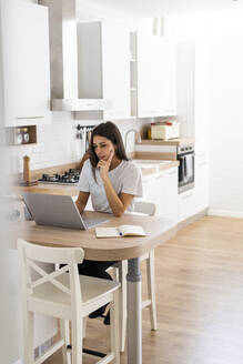 Young woman using laptop at home - GIOF06927