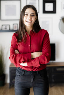 Portrait of happy young businesswoman at home - GIOF06978