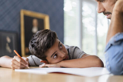 Father helping son doing homework - DIGF07742