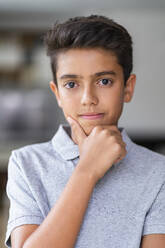 Portrait of a confident boy at home - DIGF07778