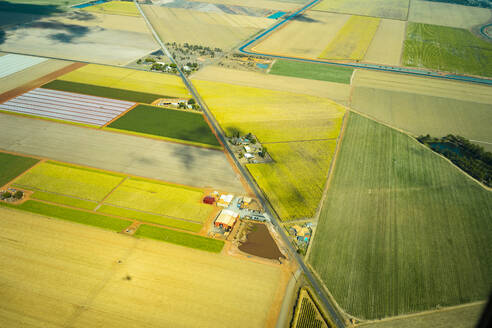 Aerial view of green cultivated fields, farms and a road in Queensland, Australia - GEMF03006