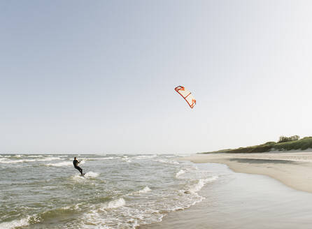 Kiteboarder riding the waves - AHSF00729