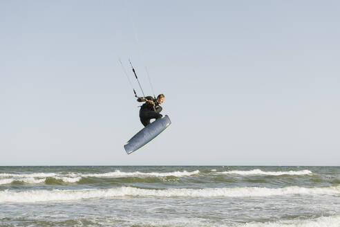 Kiteboarder jumping on the waves - AHSF00732