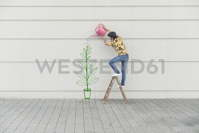 Digital composite of young man watering flower at a wall - UUF18357 - Uwe Umstätter/Westend61