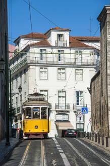 Tram moving on street of Alfama at Lisbon. Portugal - RUN02868