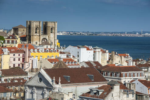 High angle view of city by river against blue sky, Lisbon, Portugal - RUNF02874
