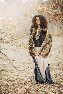 Mixed race woman wearing stylish clothes in field - BLEF12328