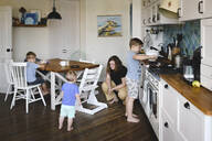 Mother with her three sons in the kitchen - EYAF00348