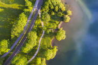 Aerial view of railroad tracks by Lake Schliersee, Bavaria, Germany - SIEF08829