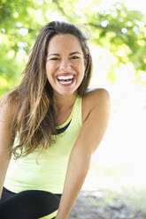 Mixed race woman laughing outdoors - BLEF12419