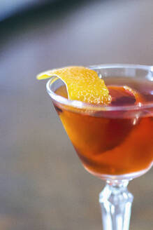 Close up of lemon peel in cocktail - BLEF12479