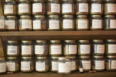 Jars of variety of teas in tea shop - BLEF12530