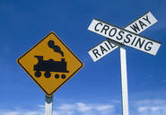 Low angle view of railway crossing signs - BLEF12668
