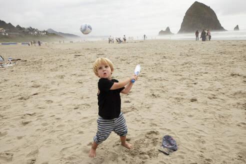 Caucasian boy playing on beach - BLEF12938
