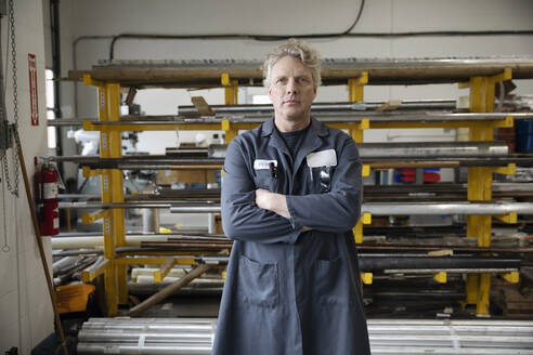 Portrait confident male machinist working in factory - HEROF37499