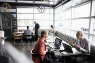 Business people meeting in bar - HEROF37577