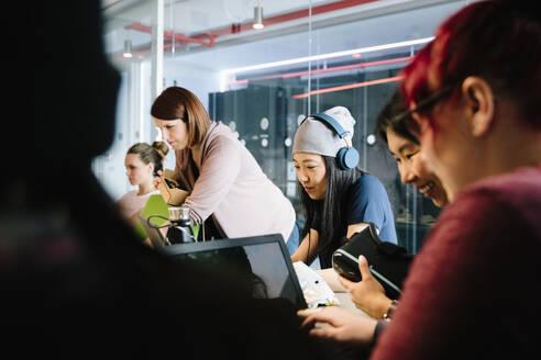 Female computer programmers working in office - HEROF37865