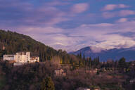 View of Alhambra with Sierra Nevada in the background at sunset, Granada, Spain - TAMF01872