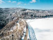 Aerial view of snow covered landscape against sky, Styria, Austria - DAWF00887