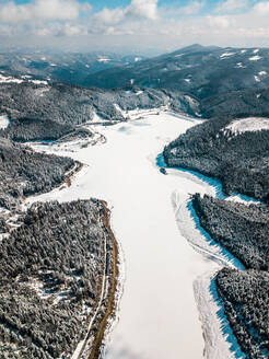 Aerial view of mountains against sky during winter, Carinthia, Austria - DAWF00893