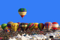 Hot air balloon floating above others at festival, Albuquerque, New Mexico, United States - BLEF13106