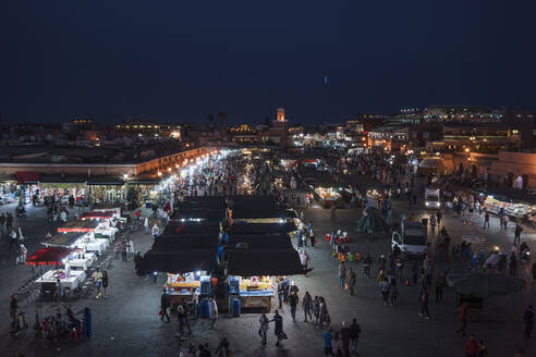 Elevated view at Djemaa el Fna by night, Marrakesh, Morocco - TAMF01971