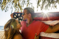 Couple holding American flag quilt - BLEF13437