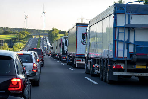 Rescue lane, cars and trucks during traffic jam in the evening, Germany - NDF00956