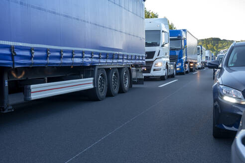 Rescue lane, cars and trucks during traffic jam in the evening, Germany - NDF00959