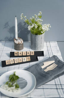 Festive table decoration with woodruff flowers and wooden cutlery - GISF00447