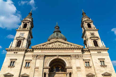 Low angle view of St. Stephen's Basilica against blue sky at Budapest, Hungary - SPCF00433