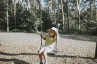 Girl on swing on a playground - DWF00463
