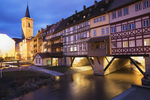 Kramerbrucke over Gera river in city at dusk, Erfurt, Germany - GWF06184