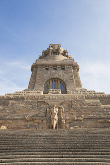 Low angle view of Völkerschlachtdenkmal against sky in Leipzig during sunny day, Saxony, Germany - GWF06200
