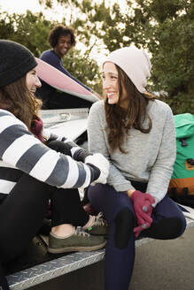 Women sitting together in truck bed - BLEF13608